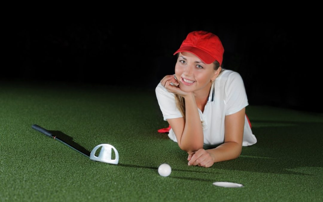 playing golf artificial grass women smiling